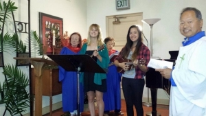 Singers and ukulele players lead St. Mary's song.
